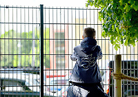 17th May 2020,Stadion An der Alten Försterei, Berlin, Germany; Bundesliga football, FC Union Berlin versus Bayern Munich;  A younf football fan sits on his fathers shoulders to watc the team arrivals through the fencing