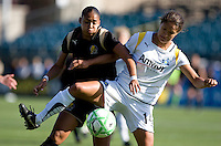 Adriane (left) battles for the ball against Stephanie Cox (14). Los Angeles Sol defeated FC Gold Pride 2-0 at Buck Shaw Stadium in Santa Clara, California on May 24, 2009.
