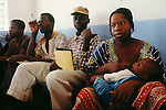 (00/55/33)-Kaya-Sanmatenga-Burkina Faso - March 07, 2000 -- A breastfeeding woman and ohter participants (men) in a literacy programme; FNS/SAN, people -- Photo: © HorstWagner.eu