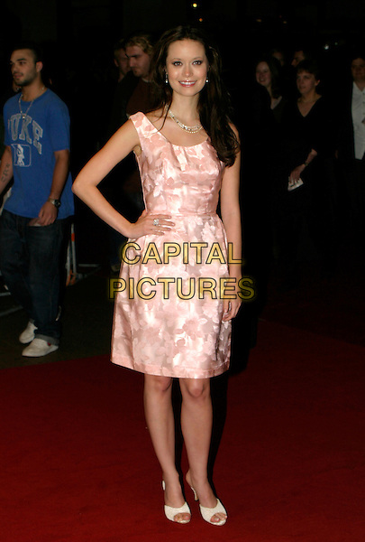 "SUMMER GLAU.UK Premiere of ""Serenity"" at the Odeon Leicester Square, London.October 5th, 2005.Ref: AH.full length pink floral dress hand on hip.www.capitalpictures.com.sales@capitalpictures.com.© Capital Pictures."
