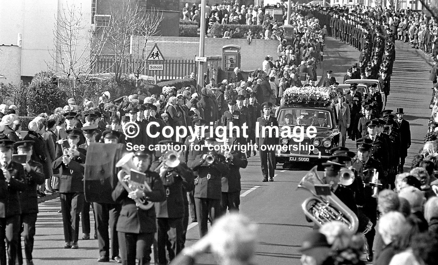 Funeral in Bangor, Co Down, N Ireland, of Reserve Policewoman Mildred Harrison. Mildred, married with two children. She was the first policewoman to die in the Troubles. The funeral is headed by the RUC Band. Mildred was passing the Ormeau Arms, in the High Street when a UVF bomb exploded there. It was the second UVF bomb attack on the Roman Catholic-owned premises. 197505190341b.<br /> <br /> Copyright Image from Victor Patterson,<br /> 54 Dorchester Park, <br /> Belfast, UK, BT9 <br /> <br /> t1: +44 28 9066 1296 (from Rep of Ireland 048 90661296)<br /> t2: +44 28 9002 2446 (from Rep of Ireland 048 9002 2446)<br /> <br /> m: +44 7802 353836<br /> <br /> e: victorpatterson@me.com<br /> www.victorpatterson.com<br /> <br /> Please see my Terms and Conditions of Use at www.victorpatterson.com. It is IMPORTANT that you familiarise yourself with them.<br /> <br /> Images used on the Internet must be visibly watermarked i.e. &copy; Victor Patterson<br /> within the body of the image and copyright metadata must not be deleted. Images <br /> used on the Internet have a size restriction of 4kbs and will be chargeable at current<br />  NUJ rates unless agreed otherwise.<br /> <br /> This image is only available for the use of the download recipient i.e. television station, newspaper, magazine, book publisher, etc, and must not be passed on to any third <br /> party. It is also downloaded on condition that each and every usage is notified within 7 days to victorpatterson@me.com<br /> <br /> The right of Victor Patterson to be identified as the author is asserted in accordance with The Copyright Designs And Patents Act (1988). All moral rights are asserted.