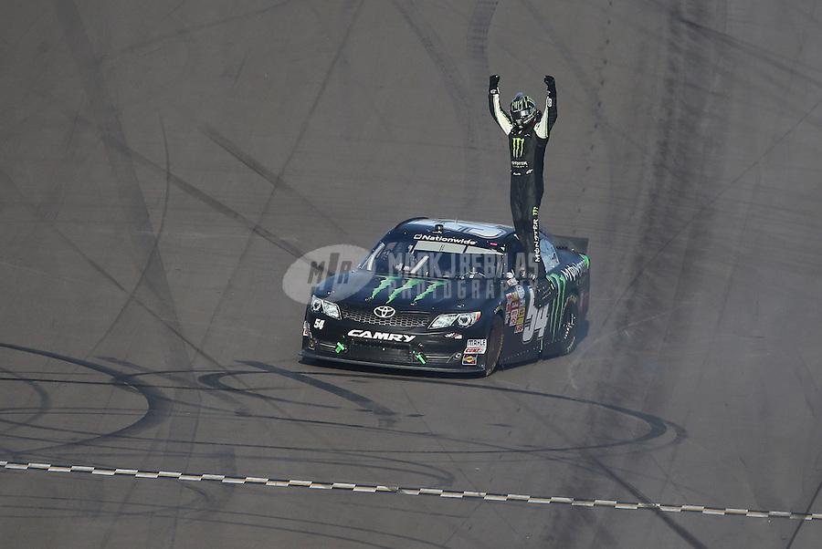 Mar. 2, 2013; Avondale, AZ, USA; NASCAR Nationwide Series driver Kyle Busch celebrates after winning the Dollar General 200 at Phoenix International Raceway. Mandatory Credit: Mark J. Rebilas-