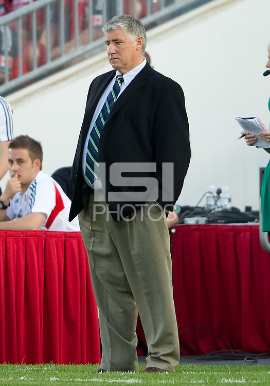 Seattle Sounders FC head coach Sigi Schmid watches the action during an MLS game between the Seattle Sounders FC and the Toronto FC at BMO Field in Toronto on June 18, 2011..The Seattle Sounders FC won 1-0.