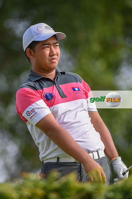 Thammalack BOUAHOM (LAO) watches his tee shot on 4 during Rd 1 of the Asia-Pacific Amateur Championship, Sentosa Golf Club, Singapore. 10/4/2018.<br /> Picture: Golffile | Ken Murray<br /> <br /> <br /> All photo usage must carry mandatory copyright credit (© Golffile | Ken Murray)