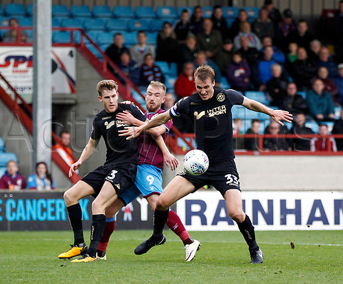 7th October 2017, Glanford Park, Scunthorpe, England; EFL League One football, Scunthorpe versus Wigan; Dan Burn and Callum Elder of Wigan Athletic combine to deny Paddy Madden of Scunthorpe United late in the 1-2 win for Wigan Athletic