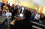 Vasile Petre, the presbyter at the Pentecostal church in Barbulesti, Romania, is leading the prayer during the Sunday mass. Before converting he was involved in robberies and used to carry side arms. 15 years ago, the population of Barbulesti, a village situated in the south of Romania and inhabited mostly by ROMa people, started to convert to the Pentecostal Church. Believers say that conversion led to a decrease in crime in the area, although official statistics do not confirm it.
