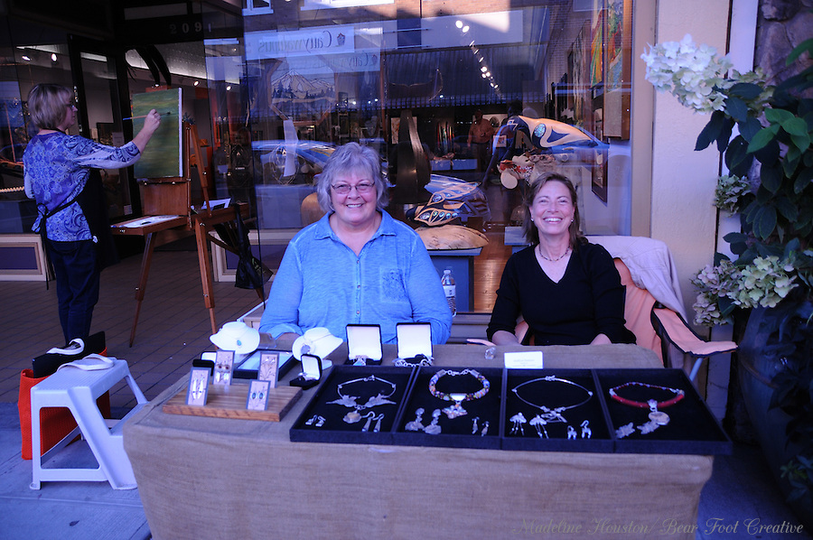Artists Nancy Wigley and Pauline Phillips sell their jewelry during Centralia, Washington's Third Thursday on September 15, 2016.