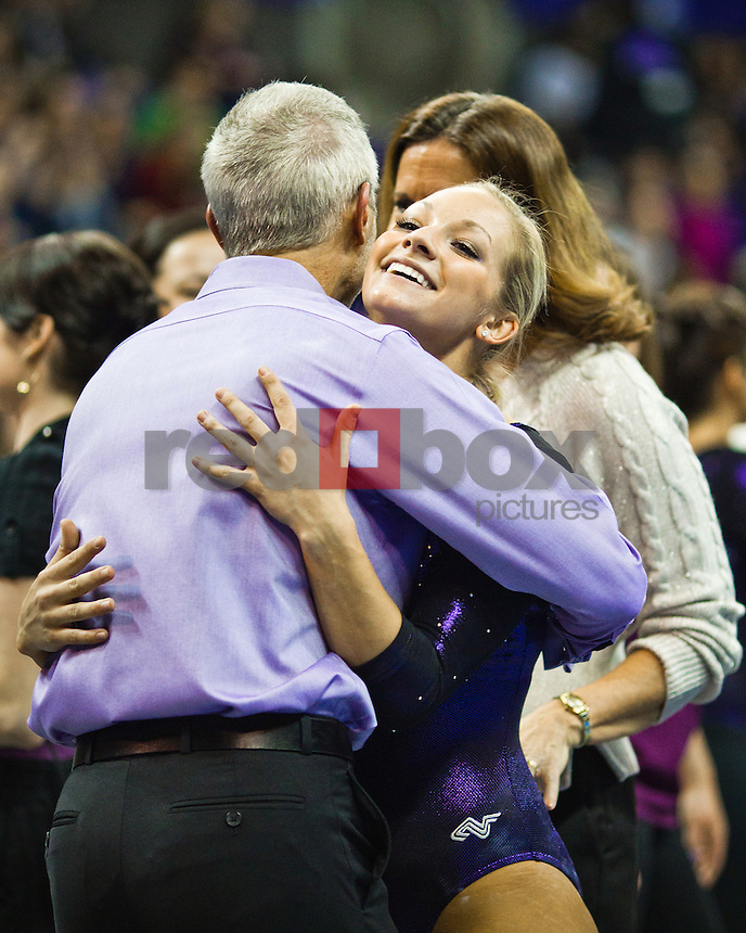 Paige Bixler, David McCreary - Assistant Coach...Washington Huskies gymnastics vs. the UCLA Bruins at Alaska Airlines Arena at Hec Edmundson Pavilion in Seattle on Friday, January 27, 2012. (Photo by Dan DeLong/Red Box Pictures)