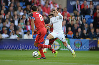 Cardiff City Stadium, Cardiff, South Wales - Tuesday 12th Aug 2014 - UEFA Super Cup Final - Real Madrid v Sevilla - <br /> <br /> Real Madrid&rsquo;s Gareth Bale (c) attempts to break through the Sevilla defence. <br /> <br /> <br /> <br /> <br /> Photo by Jeff Thomas/Jeff Thomas Photography
