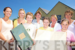CALL THE ROLL: Staff and pupils of Curraheen school in Glenbeigh which is 100 years old this year with the first roll books for the school, front l-r: Aran Mulvihill, Danielle O'Connor, Caitriona Walsh. Back l-r: Muireann O'Donovan, Michelle Kelly, Helen Murphy (Principal), Evelyn O'Shea, Marian Cronin.