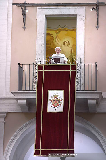Pope Benedict XVI   leads the Sunday Angelus prayer from the balcony of his summer residence in Castelgandolfo on the outskirts of Rome on July 8, 2012.