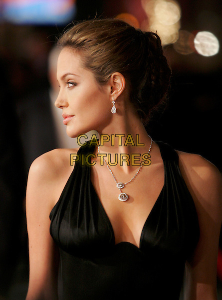 "ANGELINA JOLIE.Attends The Warner Brothers' World Premiere of ""Alexander"" held at The Graumann's Chinese Theatre in Hollywood, California, USA, November 16th 2004.portrait headshot profile silver diamond necklace.Ref: DVS.www.capitalpictures.com.sales@capitalpictures.com.©Debbie VanStory/Capital Pictures"