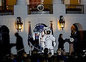 United States President Barack Obama gets prepares look through a telescope with the help of Agatha Sofia Alvarez-Bareiro after delivering remarks at the second White House Astronomy Night attended by students, teachers, scientists, astronauts and others in the South Lawn of the White House in Washington, DC. <br /> Credit: Aude Guerrucci / Pool via CNP