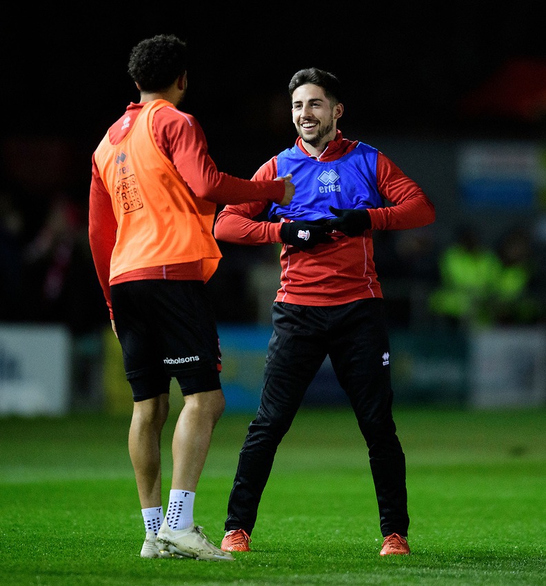 Lincoln City's Bruno Andrade, left, and Lincoln City's Tom Pett during the pre-match warm-up<br /> <br /> Photographer Chris Vaughan/CameraSport<br /> <br /> The EFL Sky Bet League Two - Lincoln City v Yeovil Town - Friday 8th March 2019 - Sincil Bank - Lincoln<br /> <br /> World Copyright © 2019 CameraSport. All rights reserved. 43 Linden Ave. Countesthorpe. Leicester. England. LE8 5PG - Tel: +44 (0) 116 277 4147 - admin@camerasport.com - www.camerasport.com