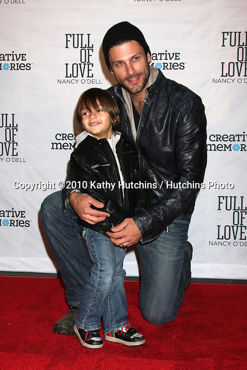 "LOS ANGELES - OCT 25:  Greg Vaughn & Family arrives at the ""Full of Love""  Book Launch Party at SLS Hotel on October 25, 2010 in Beverly Hills, CA"
