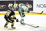 Stockholm 2014-03-21 Ishockey Kvalserien AIK - R&ouml;gle BK :  <br /> R&ouml;gles Erik Thorell i kamp om pucken med AIK:s Derek Joslin <br /> (Foto: Kenta J&ouml;nsson) Nyckelord: