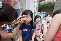 Apgujeong. Fashionable Rodeo Street shopping area. Make-up demonstration and promo.