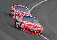 Oct. 11, 2009; Fontana, CA, USA; NASCAR Sprint Cup Series driver Tony Stewart leads Kasey Kahne during the Pepsi 500 at Auto Club Speedway. Mandatory Credit: Mark J. Rebilas-