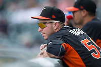 Oliver Drake (59) of the Norfolk Tides watches the action from the dugout during the game against the Charlotte Knights at BB&T BallPark on June 7, 2015 in Charlotte, North Carolina.  The Tides defeated the Knights 4-1.  (Brian Westerholt/Four Seam Images)
