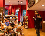 July 26, 2017. Raleigh, North Carolina.<br /> <br />  Alan Gratz took questions after he read from his new book &quot;Refugee&quot;.<br /> <br /> Author Alan Gratz spoke about and signed his new book &quot;Refugee&quot; at Quail Ridge Books. The young adult fiction novel contrasts the stories of three refugees from different time periods, a Jewish boy in 1930's Germany , a Cuban girl in 1994 and a Syrian boy in 2015.