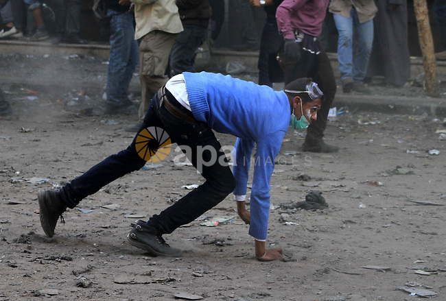 Egyptian protestors clash with riot police, not pictured, near Tahrir square in Cairo, Egypt, Wednesday, Nov. 23, 2011. Egyptian police are clashing with anti-government protesters for a fifth day in Cairo. Tens of thousands of protesters in Tahrir Square have rejected a promise by Egypt's military ruler to speed up a presidential election to the first half of next year. They want Field Marshal Hussein Tantawi to step down immediately in favor of an interim civilian council. Photo by Ashraf Amra