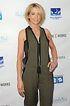 Jenna Elfman arriving at the '5th Annual Milk and Bookies Story Time Celebration' held at the Skirball Cultural Center Los Angeles, CA. April 27, 2014.