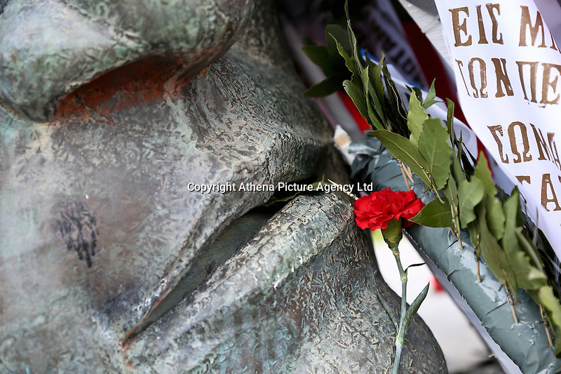 Pictured: A carnation is left at the uprising monument at the Athens Polytechinc in Athens Greece. Wednesday 16 November 2016<br /> Re: 43rd anniversary of the Athens Polytechnic uprising of 1973 which was a massive demonstration of popular rejection of the Greek military junta of 1967–1974. The uprising began on November 14, 1973, escalated to an open anti-junta revolt and ended in bloodshed in the early morning of November 17 after a series of events starting with a tank crashing through the gates of the Polytechnic.