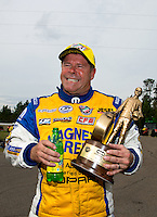 Mar 16, 2014; Gainesville, FL, USA; NHRA pro stock driver Allen Johnson celebrates after winning the Gatornationals at Gainesville Raceway Mandatory Credit: Mark J. Rebilas-USA TODAY Sports