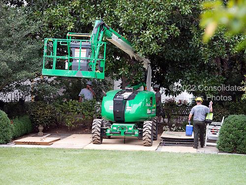 Construction crane in the Rose Garden of the White House looking from the Oval Office in Washington, DC as it is undergoing renovations while United States President Donald J. Trump is vacationing in Bedminster, New Jersey on Friday, August 11, 2017.<br /> Credit: Ron Sachs / CNP