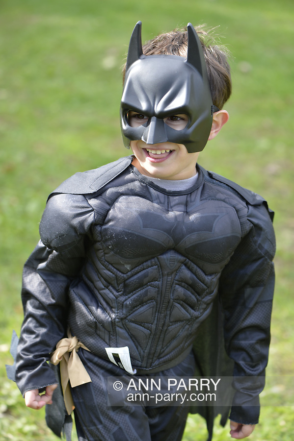 Merrick, New York, USA. October 29, 2016. Wearing a Bat Man costume, a young boy from Merrick enjoys the 2016 annual Merrick Spooktacular hosted by the North and Central Merrick Civic Association (NCMCA) and the Printing Emporium. The holiday party at Fraser Park was sponsored by the Merrick American Legion Auxiliary Unit 1282.