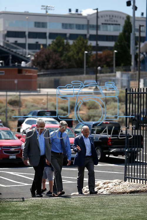 From left, Democratic governor candidate Steve Sisolak, University of Nevada, Reno Athletic Director Doug Knuth, center, and Raiders president Marc Badain tour the campus in Reno, Nev., on Thursday, Aug. 16, 2018. The Raiders are considering several potential training camp locations in Reno. (Cathleen Allison/Las Vegas Review-Journal)