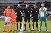 Blackpool's Jay Spearing and Gary Sawyer pose with referee Set Stockbridge, assistants Paul Newhouse and Lee Freeman and the match mascot<br /> <br /> Photographer Kevin Barnes/CameraSport<br /> <br /> The EFL Sky Bet League One - Blackpool v Plymouth Argyle - Saturday 30th March 2019 - Bloomfield Road - Blackpool<br /> <br /> World Copyright © 2019 CameraSport. All rights reserved. 43 Linden Ave. Countesthorpe. Leicester. England. LE8 5PG - Tel: +44 (0) 116 277 4147 - admin@camerasport.com - www.camerasport.com