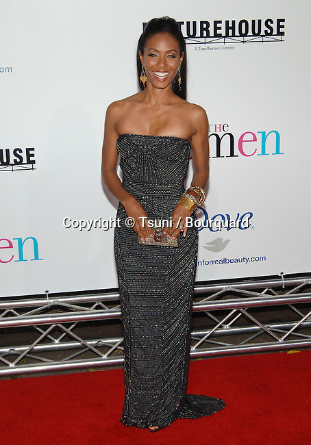 Jada Pinkett -<br /> The Women Premiere at the Westwood Village Theatre In Los Angeles.<br /> <br /> full length<br /> eye contact<br /> smile