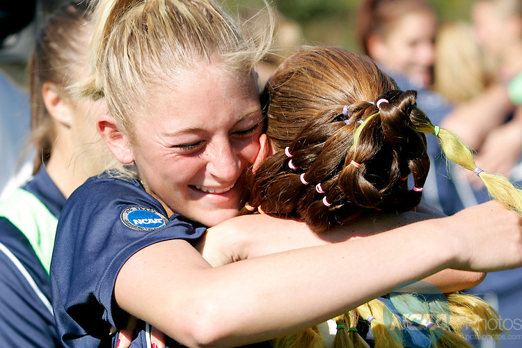18 November 2006: Metro State's Nicole Cito (left) hugs teammate Kira Sharp after Sharp scored the game winning goal in overtime during the 2006 NCAA Division II Women's Soccer Championship held at Escambia County Stadium in Pensacola, FL.  The Road Runners defeated Grand Valley State 1-0 to take home their second title in three years.  The championship was part of the Division II Sports Festival in Pensacola. Trevor Brown, Jr./NCAA Photos.
