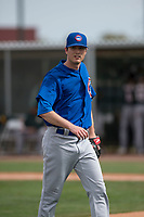 Chicago Cubs relief pitcher Preston Morrison (33) walks off the field between innings of a Minor League Spring Training game against the Oakland Athletics at Sloan Park on March 13, 2018 in Mesa, Arizona. (Zachary Lucy/Four Seam Images)