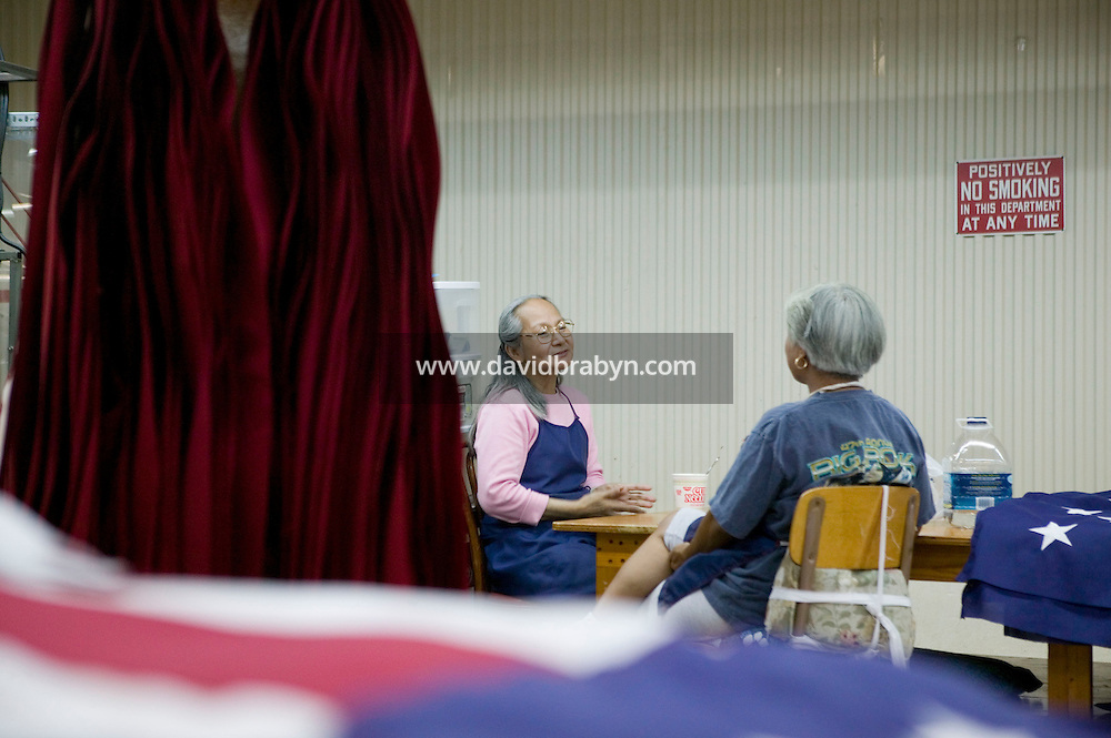 21 June 2005 - Oaks, PA - Leonor Ebba (L) and Connie Roby (R) chat during their lunch break at the Annin & Co. American flag manufacturing plant in Oaks, PA. Photo Credit: David Brabyn.