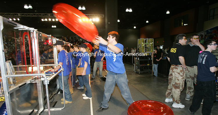 HARTFORD, CT. 16 March 2007--16_NEW_031607SV05--Ben Thompson, 16, of Watertown High School tosses a tube into the ring during a match at the United Technologies Connecticut Regional 2007 First Robotics Competition at the Connecticut Convention Center in Hartford Friday.<br /> Steven Valenti Republican-American