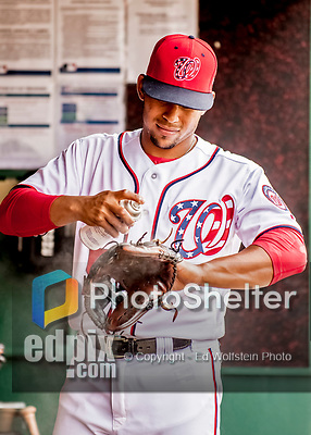 8 July 2017: Washington Nationals infielder Adrian Sanchez tends to his glove in the dugout prior to a game against the Atlanta Braves at Nationals Park in Washington, DC. The Braves shut out the Nationals 13-0 to take the third game of their 4-game series. Mandatory Credit: Ed Wolfstein Photo *** RAW (NEF) Image File Available ***