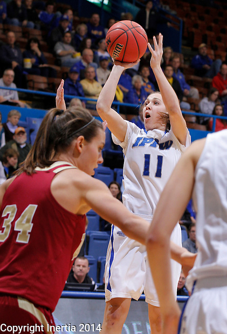SIOUX FALLS, SD - MARCH 9:  Amanda Hyde #11 of IPFW shoots over Denver defenders during their quarterfinal game at the 2014 Summit League Basketball Championships Sunday at the Sioux Falls Arena.  (Photo by Dick CarlsonInertia)