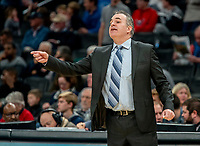 WASHINGTON, DC - DECEMBER 28: Mike Brennan head coach of American sends in directions to his team. during a game between American University and Georgetown University at Capital One Arena on December 28, 2019 in Washington, DC.