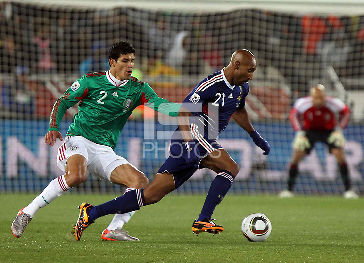Francisco Rodriguez of Mexico (L) and Nicolas Anelka of France