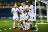 Dayle Southwell of Wycombe Wanderers (3rd left) celebrates scoring his team's first goal against Brentford to make it 1-1  during the Friendly match between Wycombe Wanderers and Brentford at Adams Park, High Wycombe, England on 19 July 2016. Photo by David Horn PRiME Media Images.