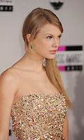 LOS ANGELES, CA - NOVEMBER 20: Taylor Swift arrives at the 2011 American Music Awards held at Nokia Theatre L.A. LIVE on November 20, 2011 in Los Angeles, California.