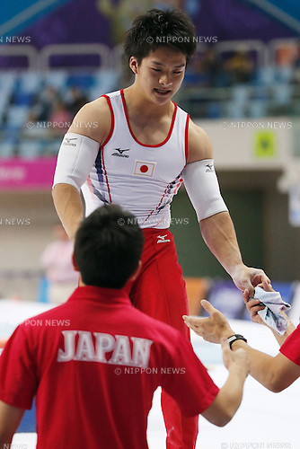 Yuya Kamoto (JPN), <br /> SEPTEMBER 21, 2014 - Artistic Gymnastics : <br /> Men's Team Final <br /> Parallel Bars <br /> at Namdong Gymnasium <br /> during the 2014 Incheon Asian Games in Incheon, South Korea. <br /> (Photo by AFLO SPORT)