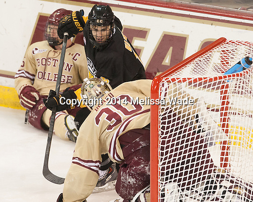 Michael Matheson (BC - 5), Alex Roos (CC - 28), Thatcher Demko (BC - 30) - The Boston College Eagles defeated the visiting Colorado College Tigers 6-2 on Friday, October 24, 2014, at Kelley Rink in Conte Forum in Chestnut Hill, Massachusetts.