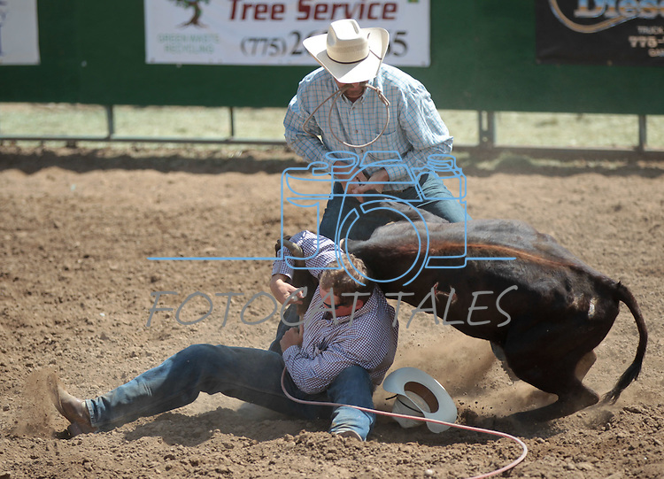 Justin Edgemon and Matt Jacks compete in the double mugging event at the Minden Ranch Rodeo in Gardnerville, Nev., on Sunday, July 22, 2012..Photo by Cathleen Allison