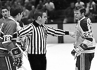 California Golden Seal Dennis Hextall ready to fight Canadiens #18 Serge Savard. (1971-72..photo/Ron Riesterer)