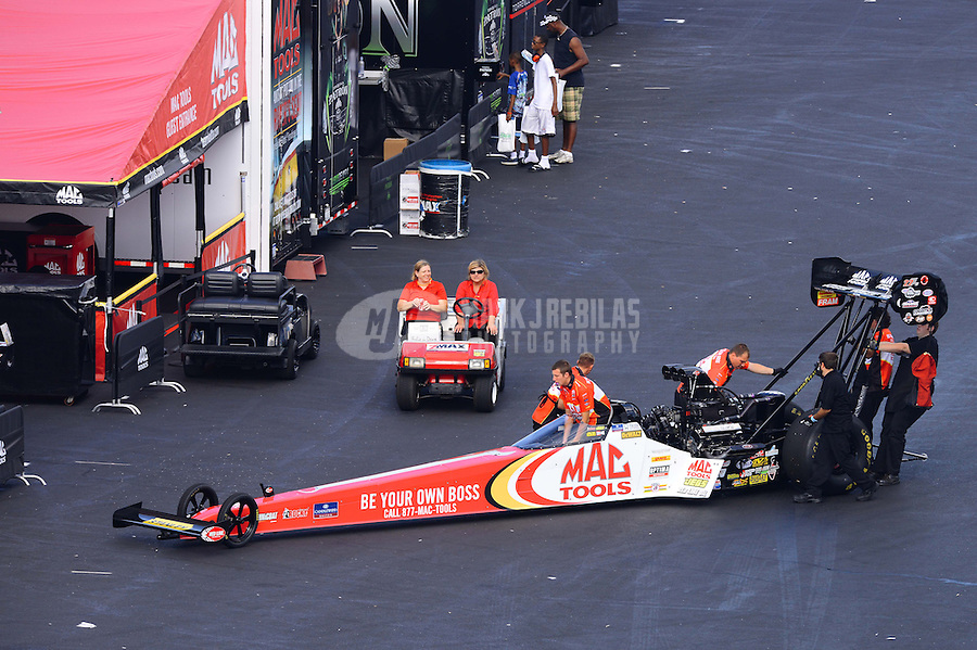 Sept. 15, 2012; Concord, NC, USA: NHRA crew members for top fuel dragster driver Doug Kalitta during qualifying for the O'Reilly Auto Parts Nationals at zMax Dragway. Mandatory Credit: Mark J. Rebilas-