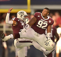 STAFF PHOTO BEN GOFF  @NWABenGoff -- 09/27/14 Texas A&M defensive lineman Zaycoven Henderson, right, and quarterback Kenny Hill celebrate after a touchdown during the fourth quarter of the Southwest Classic at AT&T Stadium in Arlington, Texas on Saturday September 27, 2014.