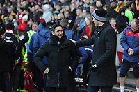 Lee Johnson Manager of Bristol City greets Graham Potter Manager of Swansea City during the Sky Bet Championship match between Bristol City and Swansea City at Ashton Gate in Bristol, England, UK. Monday 02 February 2019